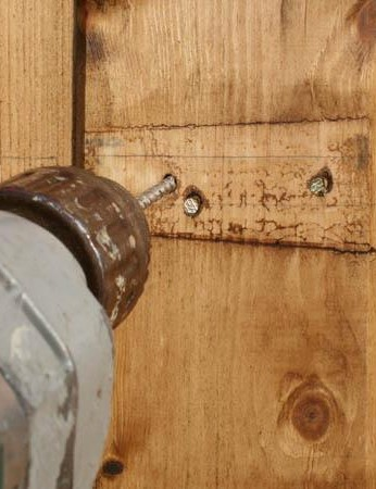 Simply widen the screw holes with a drill...
