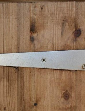 Door hinges are a major weak point, and can be toughened up by replacing the screws with bolts