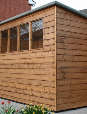 We opted for a wooden shed with a pent roof for more headroom