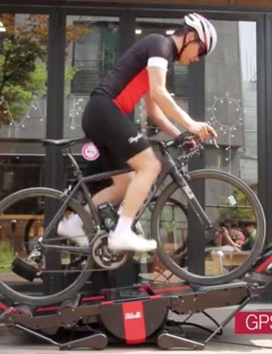 The Bitelli bike trainer tips forward and backward to simulate climbing and descending