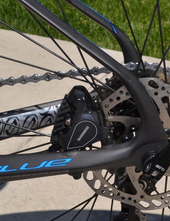 Shimano's R785 hydraulic discs are tucked in the rear triangle and provide the control