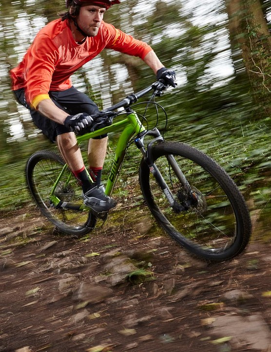 The RockShox XC 30 fork uses a coil spring that's smooth over small bumps but lacks adjustability and adds significant weight