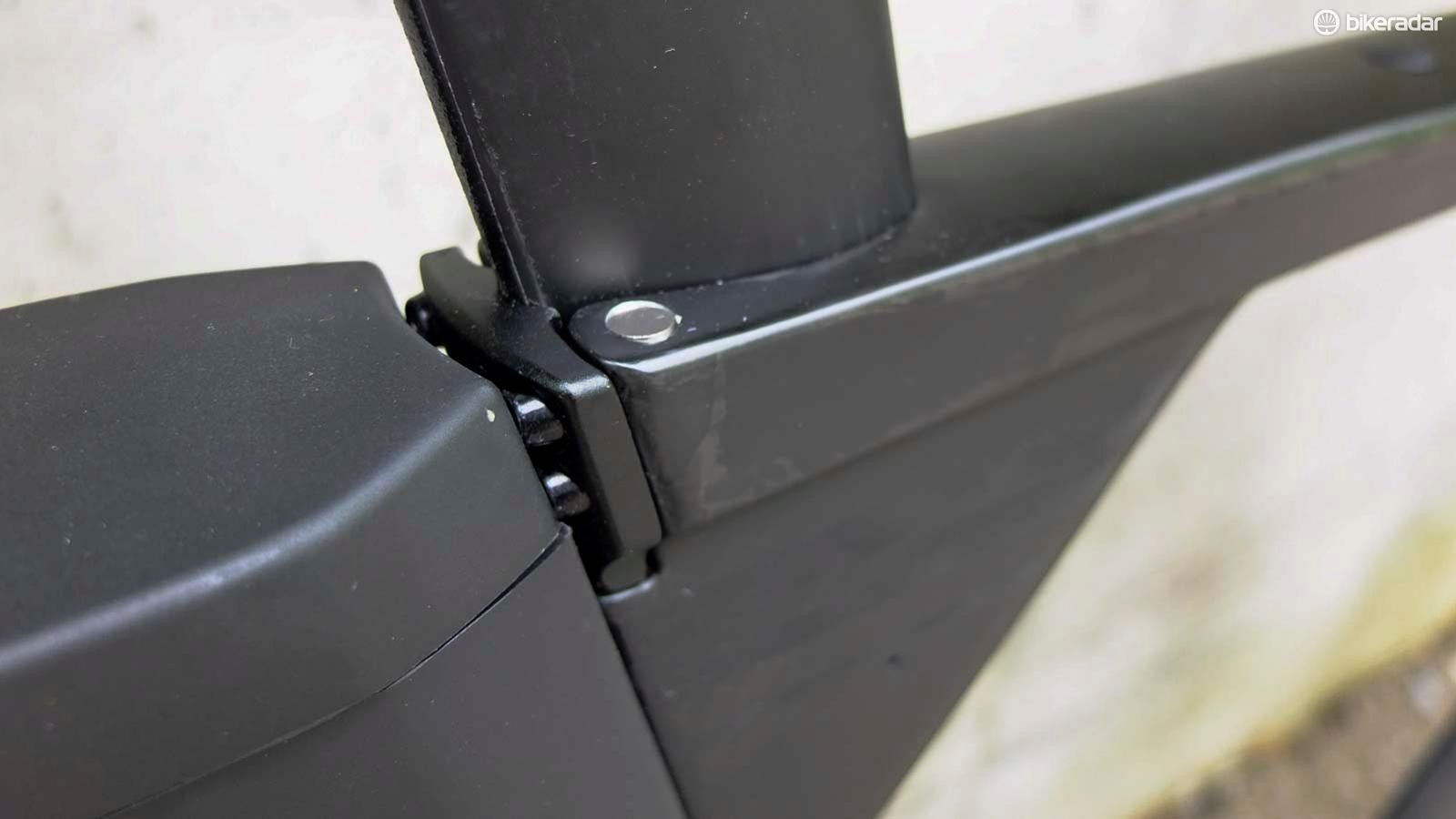 In triathlon configuration, the Timemachine 01 Disc's rear-facing seatpost clamp bolts are tucked between the frame and rear storage box