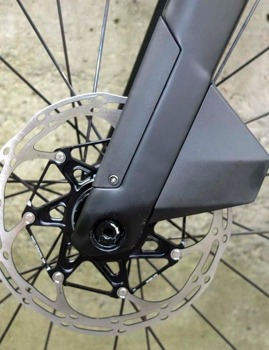 BMC has created an integrated fairing to keep the front disc caliper and hose hidden from the wind, while the rotor passes through it