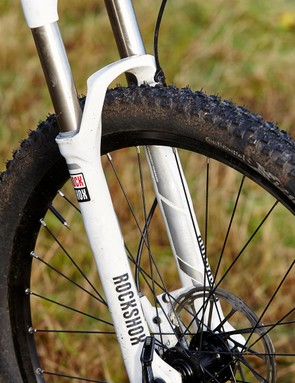 The RockShox Sektor fork plugs into the frame with a tapered steerer tube and connects securely to the front wheel with a 15mm thru-axle