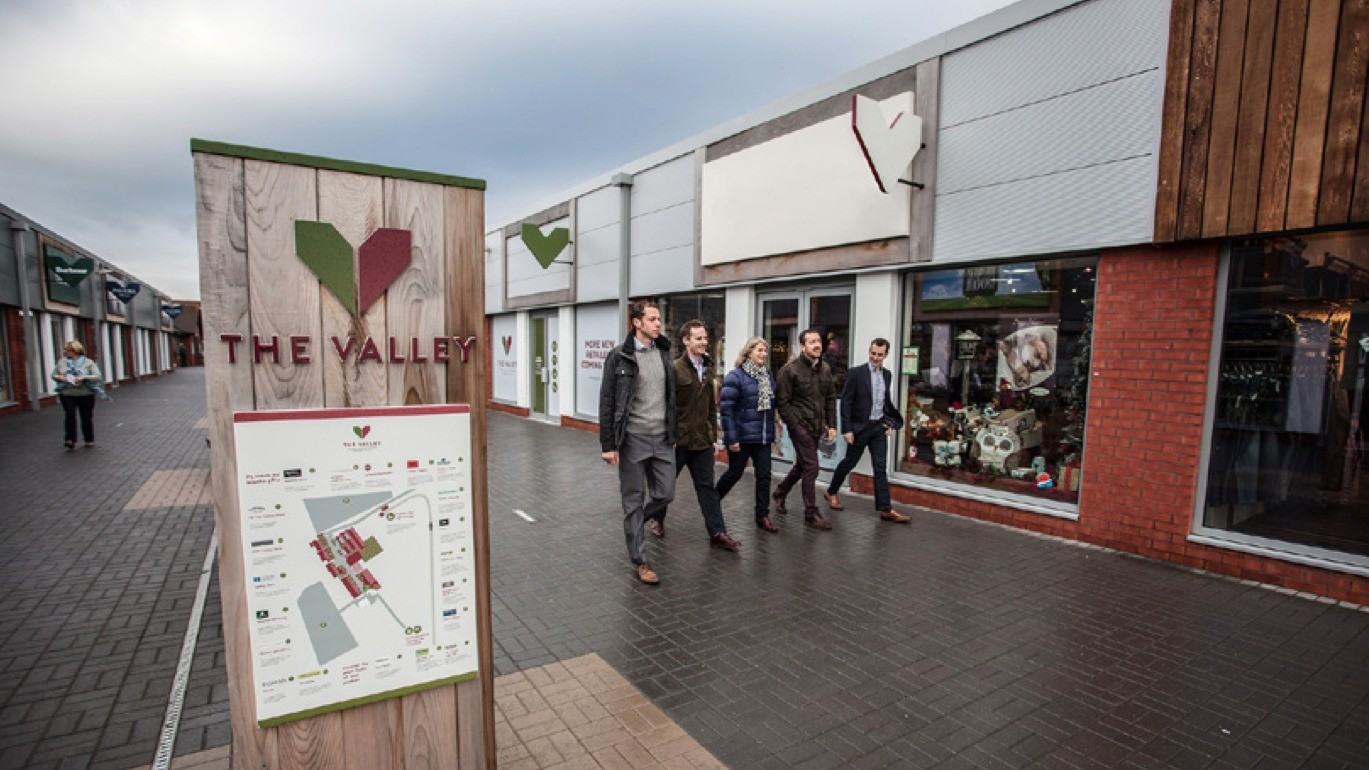 Chris Boardman (2nd from right) and team visit The Valley retail park in Worcestershire, where his new Performance Centre will be based