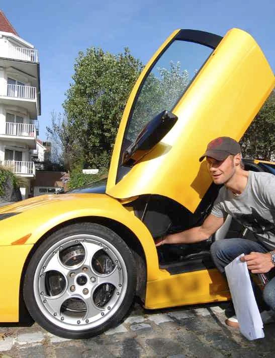 Hulsmans and Boonen admiring Tornado Tom's Lamborghini in 2006.