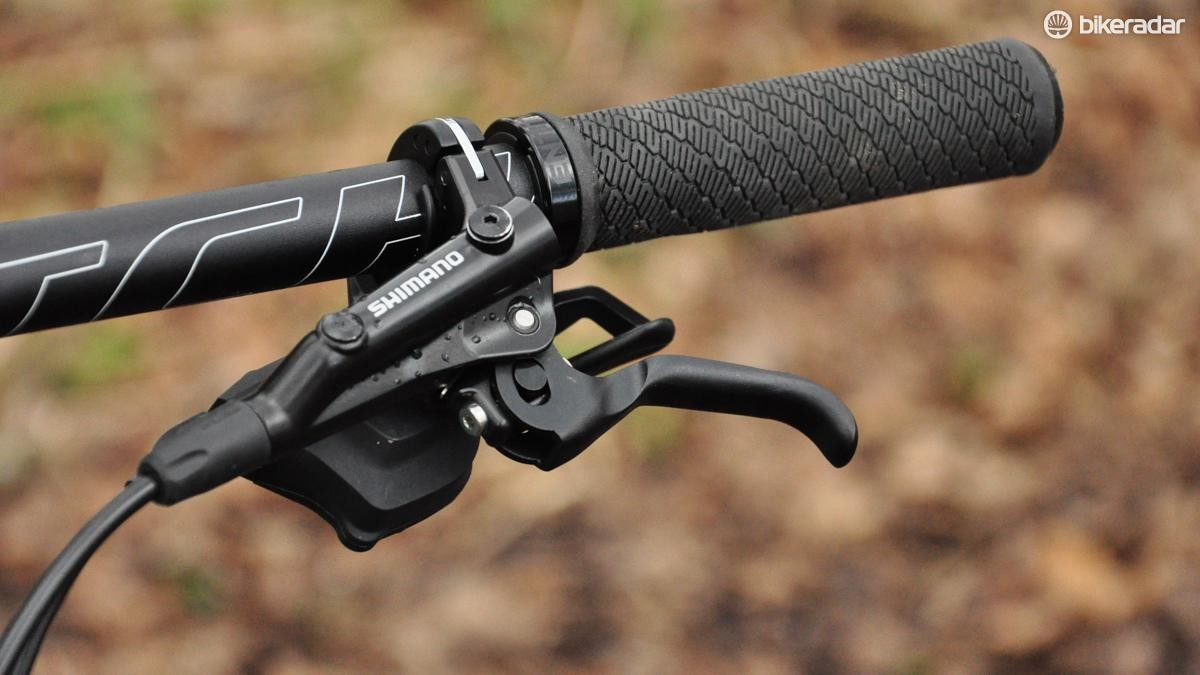 Shimano provides gearing and braking in the form of a Deore groupset with M506 levers