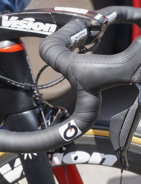 The rear-most button on the new Di2 levers are elongated enough that, on a compact bar, you can hit them with a slightly extended knuckle to shift while sprinting