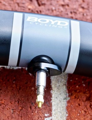 Boyd uses a clever, offset, ovalized valve nut, which was welcomed when swapping out the tubeless for a tube out on a ride