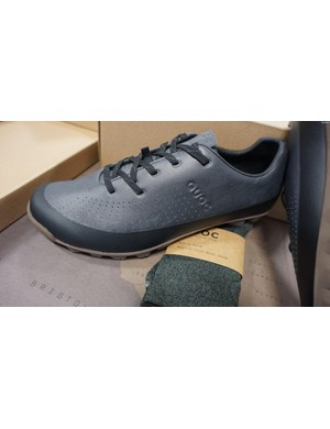 The shoes are waterproof up to the top of the black section on the sole, and even come with a matching pair of socks