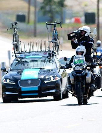 TV motos follow Bradley Wiggins on his way to victory in the 2014 Folsom Time Trial