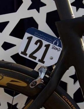Just in case the gold weren't enough to remember who's bike it is, Bradley Wiggins' name is written on his number