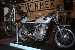 There are few better ways to arrive at the trailhead than aboard a boss motorcycle. The Yamaha café racer and matching hardtail in the Breadwinner booth were mega cool