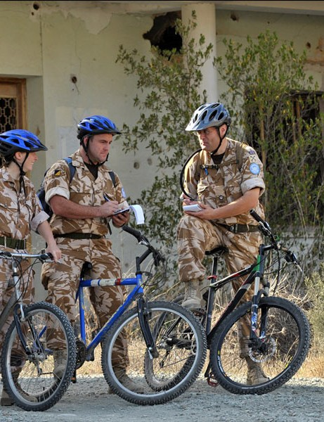 Andrew Thompson – right - briefs his bike patrol on the Green Line, Cyprus.