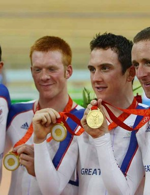 Paul Manning, Ed Clancy, Geraint Thomas and Bradley Wiggins celebrate their team pursuit victory.