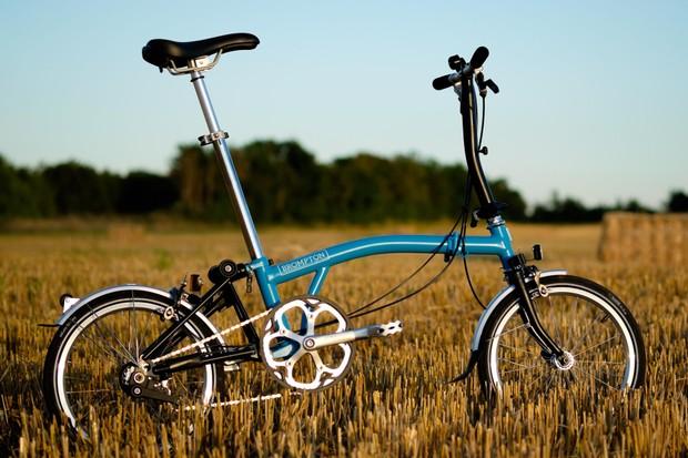 Blue Brompton bike in field