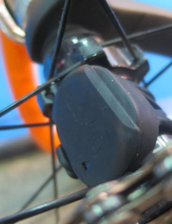 The speed sensor mounts on the hub