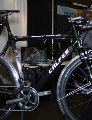 Calfee showed off its Dragonfly Adventure road bike with dynamo lighting, full fenders and integrated front rack and rear bottle holder/light