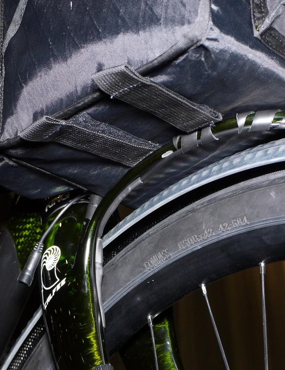 The integrated rack is made of carbon and permanently attached to the fork