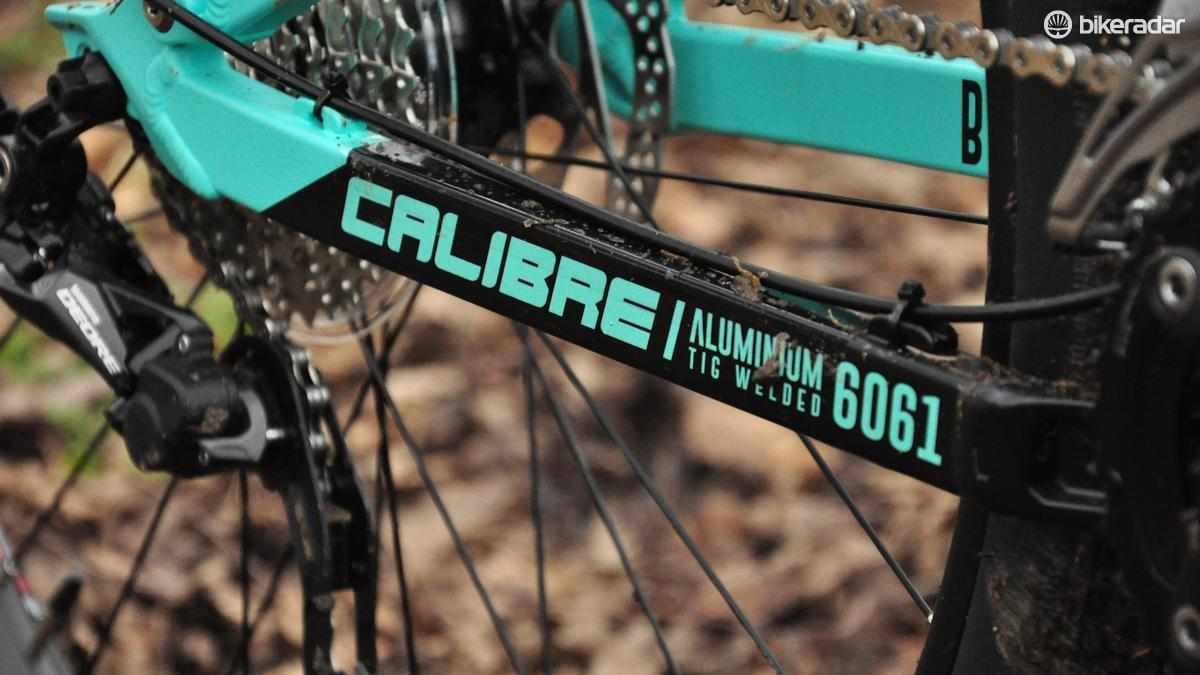 Chainstay of Calibre bike with company logo