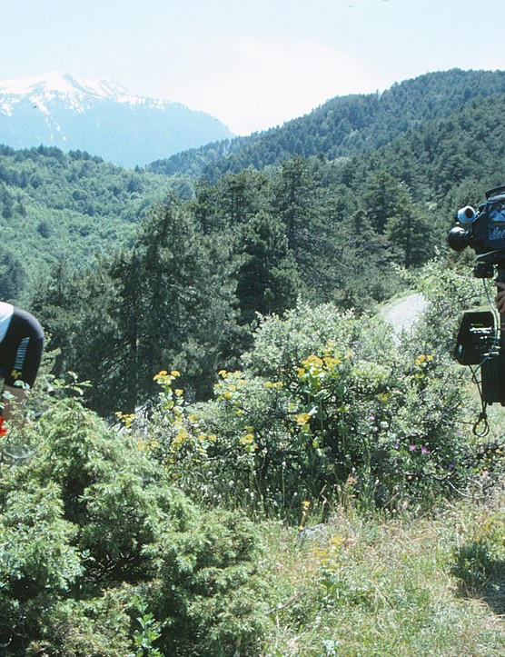 A rider heads into the bushes to avoid a cameraman - they're literally everywhere