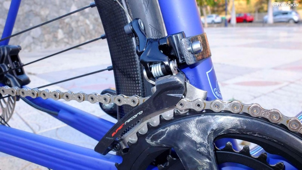 The new Super Record front mech includes some carbon fibre on the outer plate