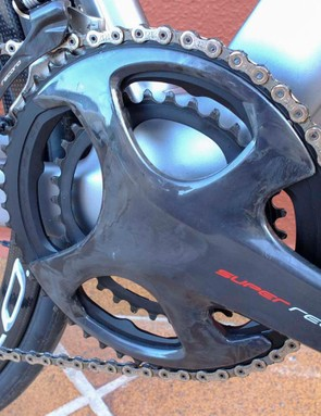Super Record's new crankset is hollow carbon fibre and features two integrated outer braces to counteract the positions of greatest torque