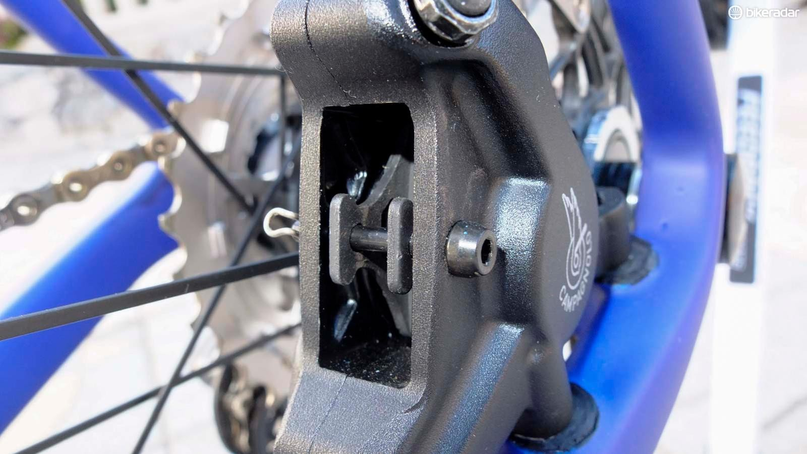 The rotor size-specific calipers have pad return springs, which are magnetic and extremely effective
