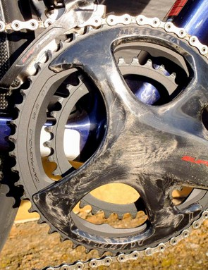 Super Record's crankset has hollow carbon fibre arms, additional bracing to counteract high torque, a titanium axle with ceramic bearings and hard anodised chain rings