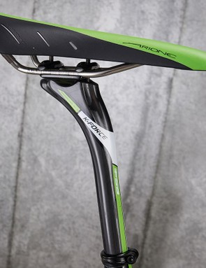 The seatpost and saddle feature pro team colours