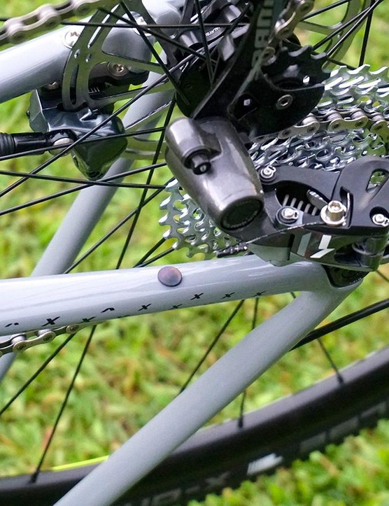 The rear derailleur exit port for Di2 is underneath the chainstay