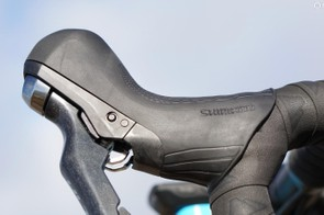 Shimano's mechanica/hydraulic levers have big but not enormous hoods. I find them comfortable