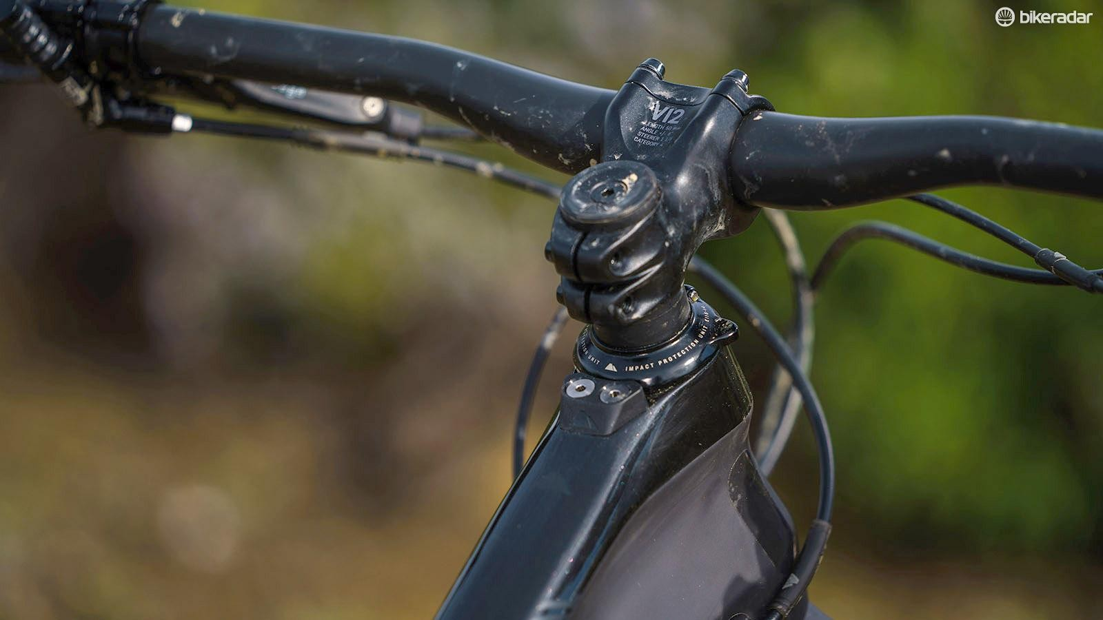 The bumper on top of the head tube prevents bars rotating far enough to damage the frame