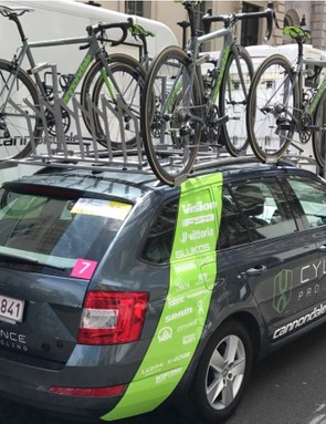 The team car with riders' spare bikes set up and ready to go — Ratto's is front right