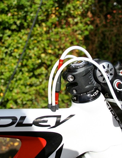 The gear and rear brake cables disappear into the top of the top tube and reappear at the rear where they're needed.