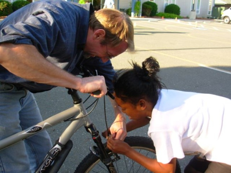 Chris Pierce helps a student in East Palo Alto.