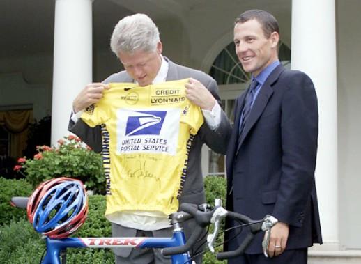 Former US president Bill Clinton congratulates Lance Armstrong on winning his first Tour de France.