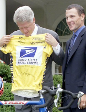 Former US president Bill Clinton congratulates Lance Armstrong on winning his first Tour de France.
