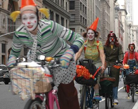 Clowns seeking out safe street for biking in New York City.