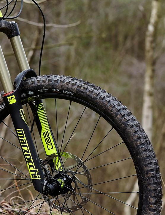 The Commencal's linear long-travel fork eats bumps but dives in the bends