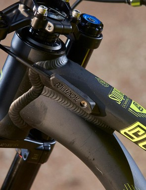 Neat integrated fork bumps protect the aluminium frame in a crash