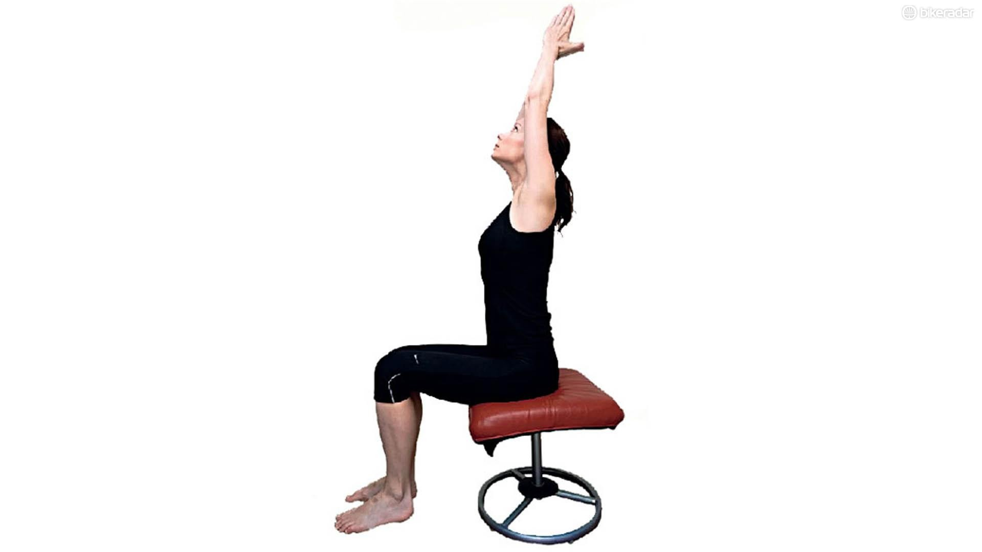 Another office chair-based stretch that will release tension in muscles throughout the back