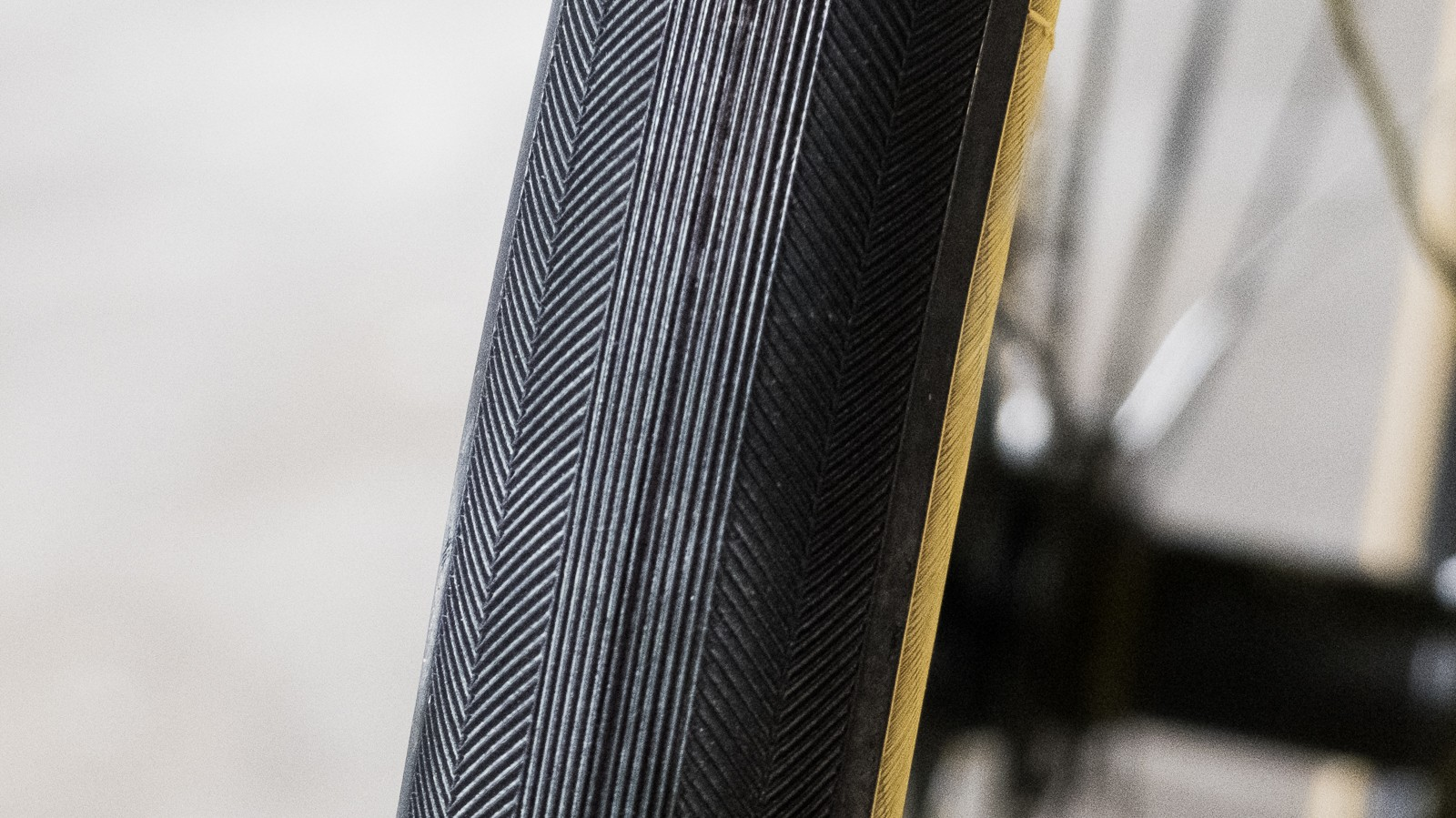 The tyres, rather uniquely for a lightweight road tyre, feature a patterned tread