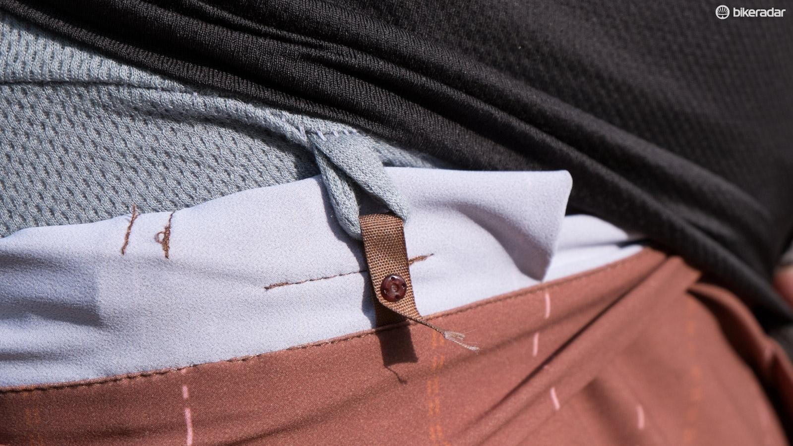 The mountain bike specific bibs snap into the shorts with these tiny attachments