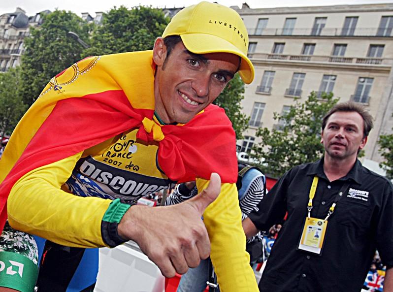Alberto Contador & Johan Bruyneel celebrate Contador's Tour victory