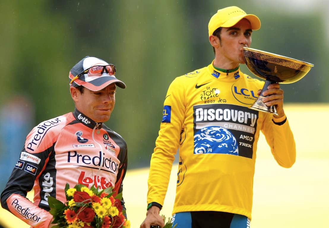 Contador and his Tour prize, a delightful black and gold bowl.