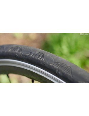The tread pattern won't really do anything for grip — the compound handles that — but the wear indicator (the small circular indention) is handy