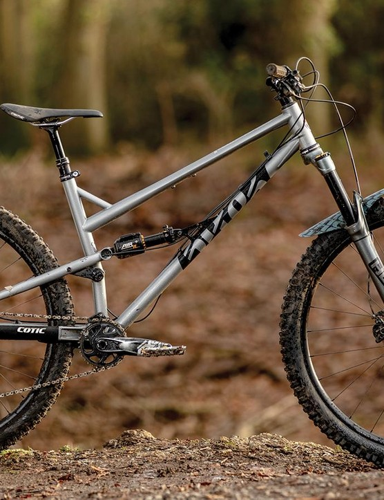 The custom Reynolds 853 steel tubing includes an 'Ovalform' top tube, 'DZB' down tube and 35mm-diameter seat tube