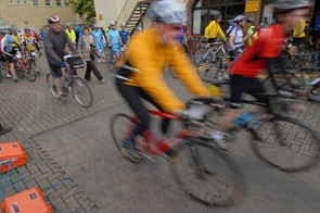 Riders leave event headquarters in Witney at the start of a tough day